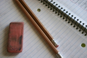 Pencil, notebook and eraser