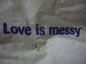 Love is messy, as written on a crumpled sheet of paper