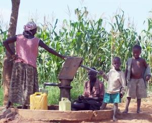 Ugandan family at water well