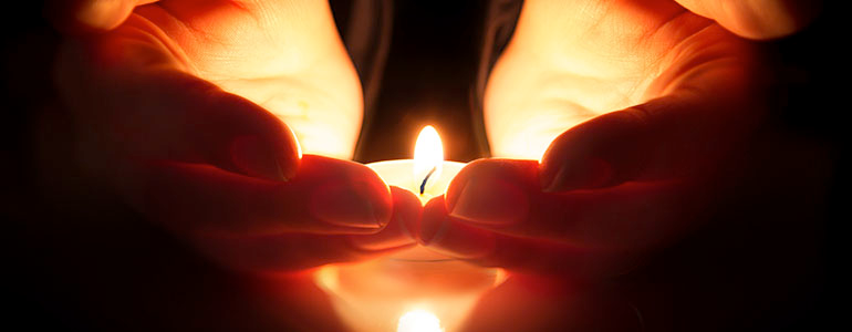 hands-candle-flame