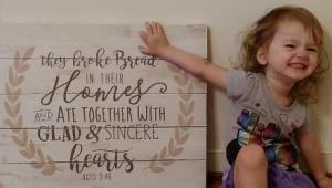 child-break-bread-sign-by-Steven-Cottam