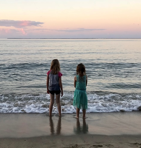 two-small-girls-looking-at-ocean