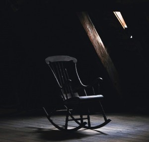 rocking-chair-dark-small-window-light