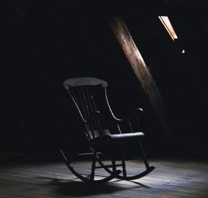 rocking-chair-dark-small-window-light